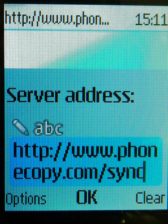 Type http://www.phonecopy.com/sync into the server address field